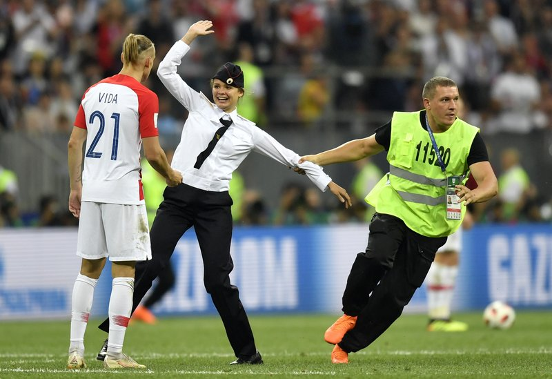 PICTURES: Pussy Riot claims on-field protest at World Cup final