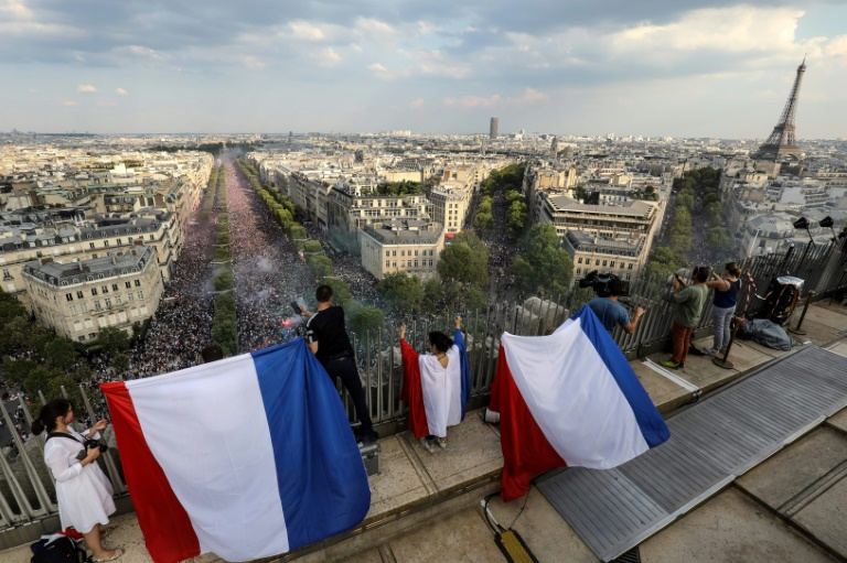 Delirious French revel in World Cup victory; hundreds of thousands party into the night
