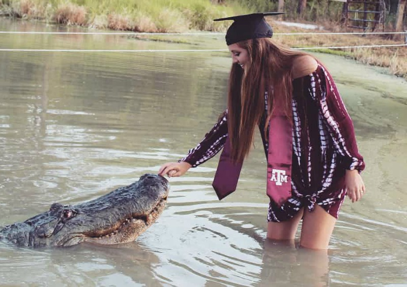 Student poses with 4m-long alligator to celebrate graduation