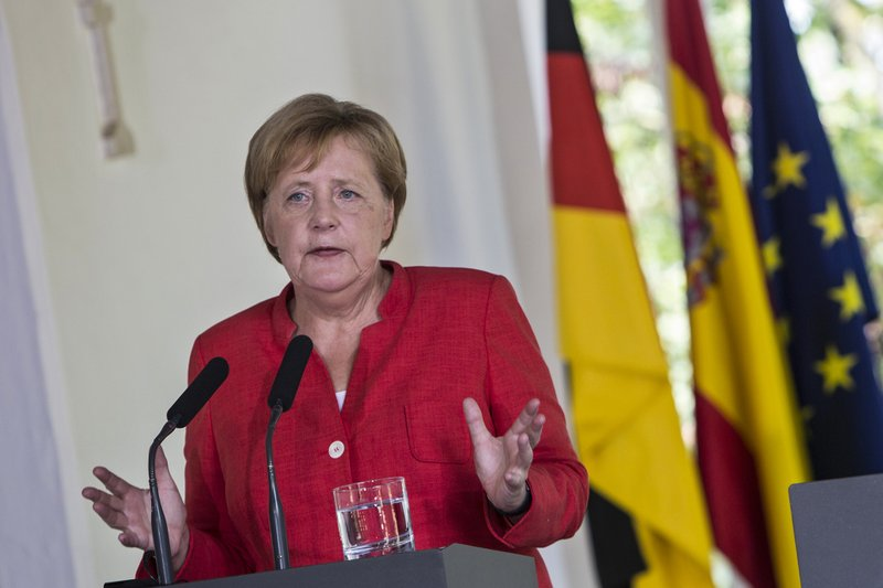 Leaders of Germany, Spain pledge united front on migration