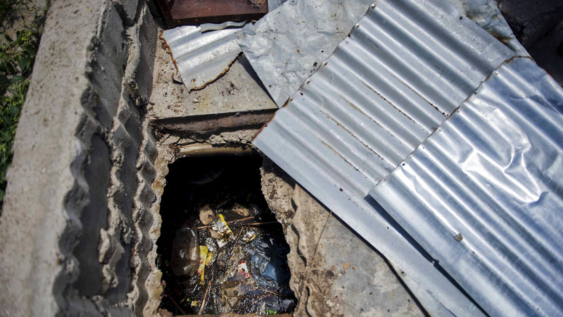 Teacher loses two children in pit latrine accident