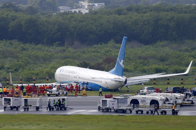 Philippines: Plane skids off rainy runway, rips off engine, wheel