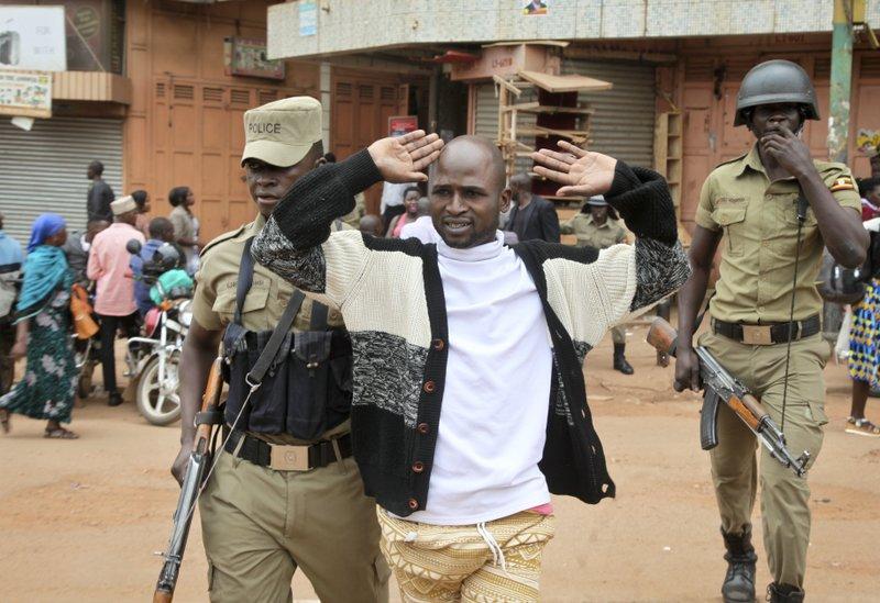 Tortured Ugandan opposition pop star flies abroad for treatment