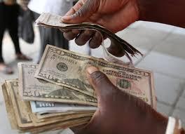 Police blitz nets 100 black market forex dealers