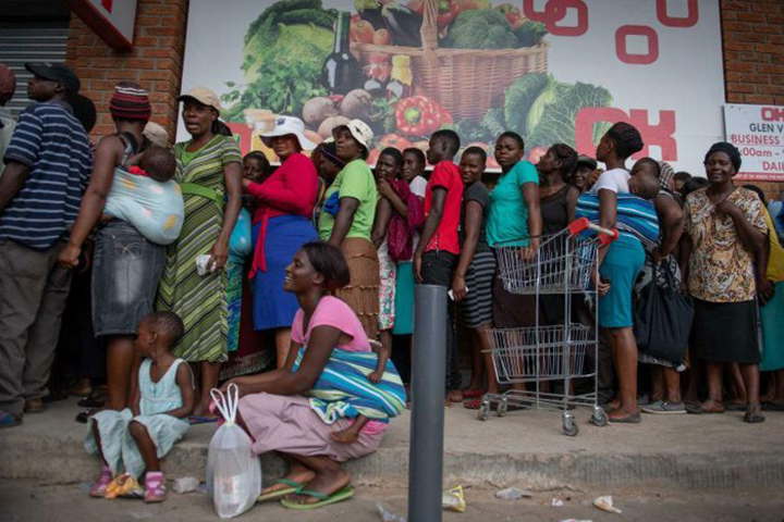 Zimbabweans sleeping in food and petrol queues as worst economic crisis in a decade deepens
