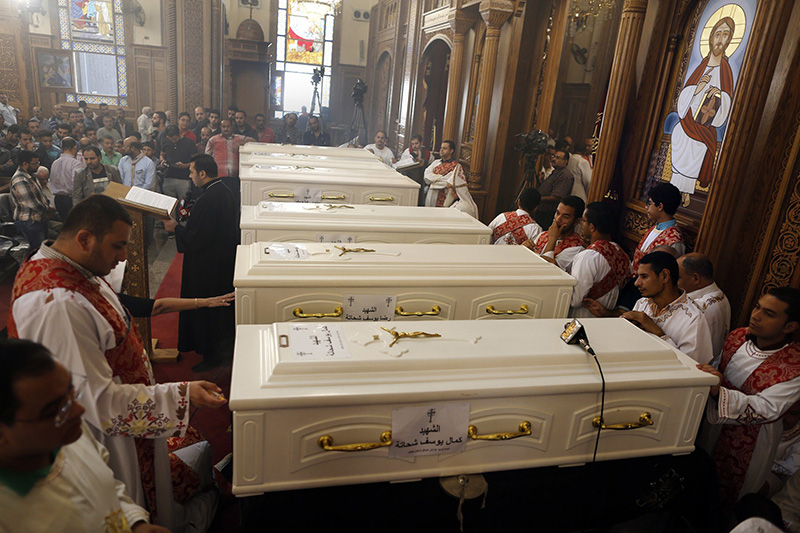 Christians in Egypt bury their dead after attack; seven killed in an ambush