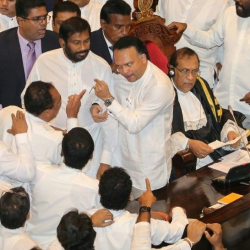 Punch-up in Sri Lankan parliament as thousands rally