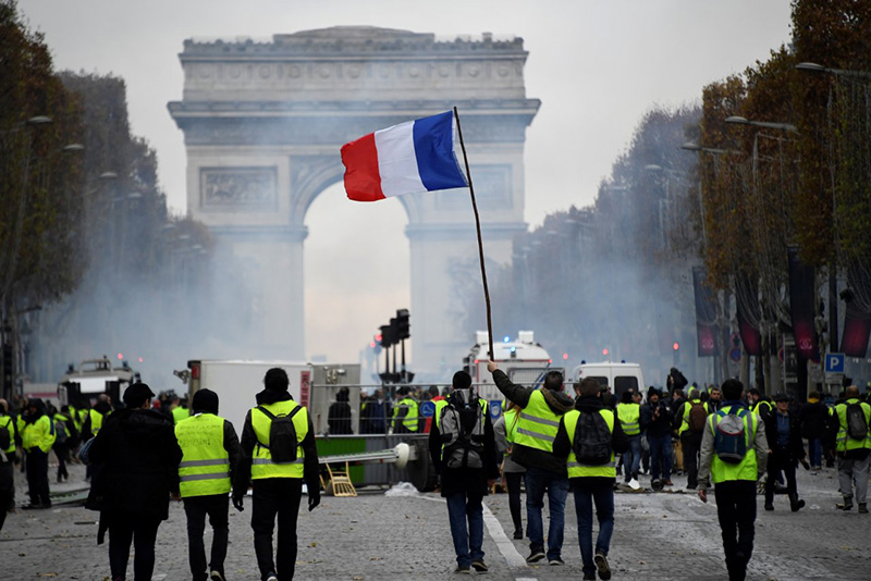 Paris police fire tear gas, water cannon against 'yellow vest' protesters
