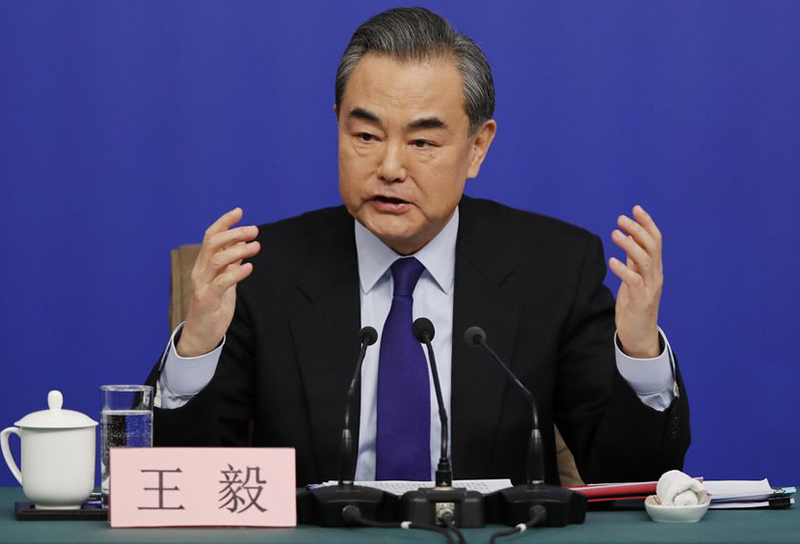 China's foreign minister vows to defend citizens abroad after Canada arrest of top executive