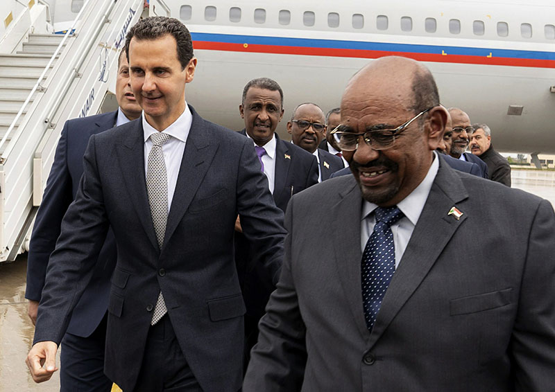 Sudan president lands in Syria in 1st visit by Arab leader