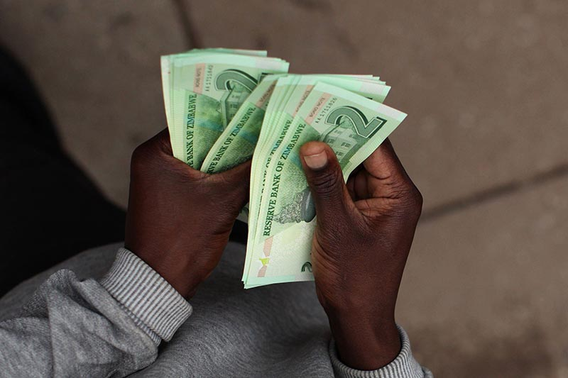 Zimbabwe finally issues fresh banknotes to ease cash shortages