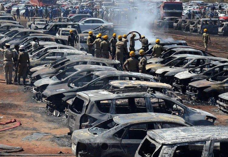 Fire at India airshow destroys hundreds of cars