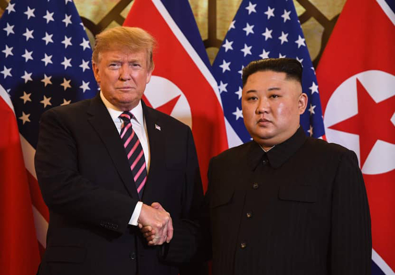 Trump, Kim handshake kicks off nuclear summit