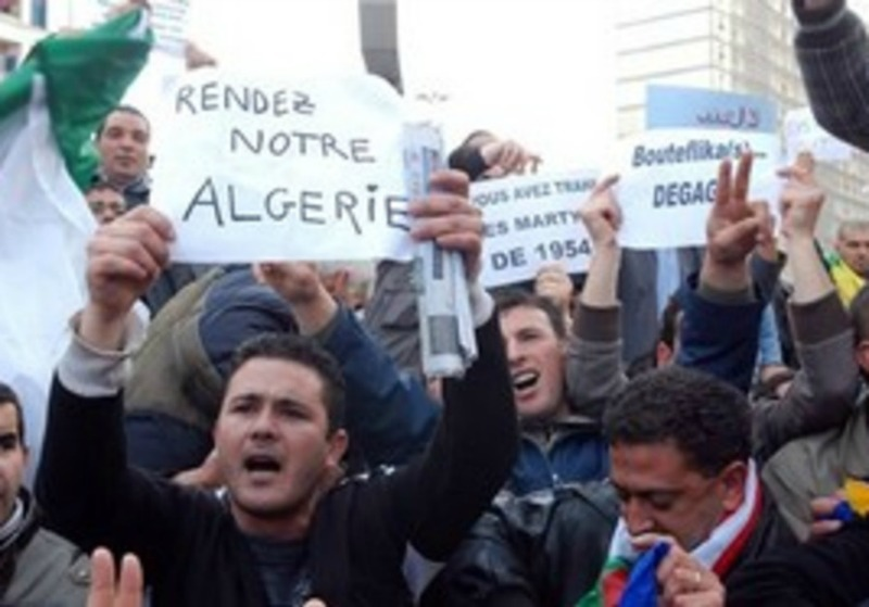 Algerian president defies protesters, seeks re-election