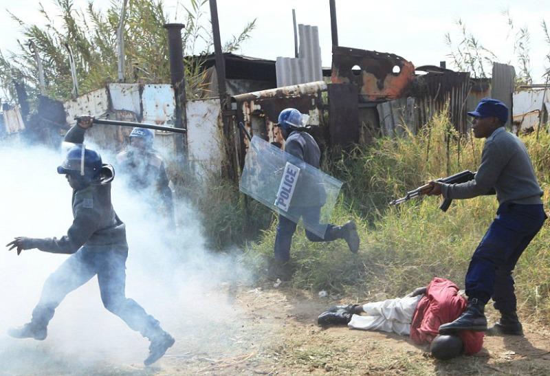 Activist finally gets compensation for brutal police assault