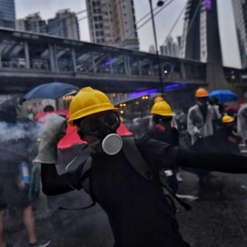 Hong Kong police shoot man in day of violence and chaos