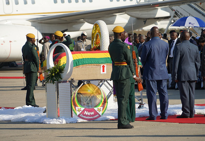 Mugabe funeral: Leaders pay tribute at quarter-full stadium
