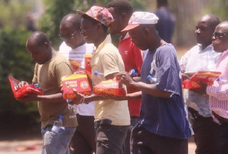 'Anti-sanctions day should come more often', says hungry Zimbabweans munching free food