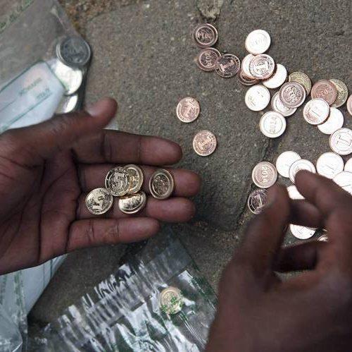 New money: Bank account holders given heaps of coins