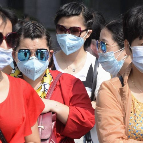 WHO warns of mask shortages as virus cases rise worldwide