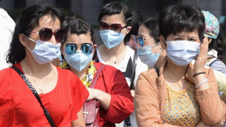 US warns against China travel, as virus death toll hits 213