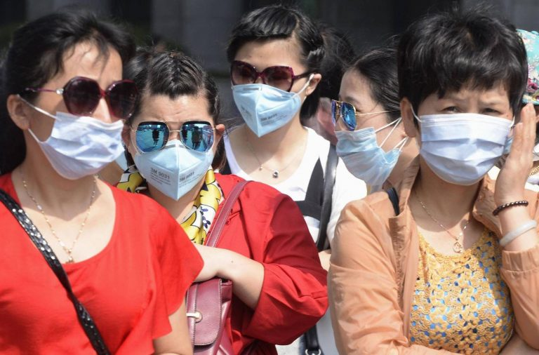 China virus cases pass 70,000 as WHO mission begins