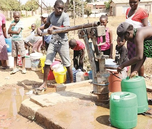 Social distancing remains challenge as residents scramble for borehole water