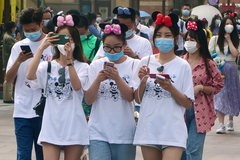 China cases rise, students back, Disney reopens