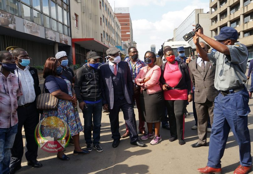 IN PICTURES: Biti, Kore Being Arrested Outside Harvest House