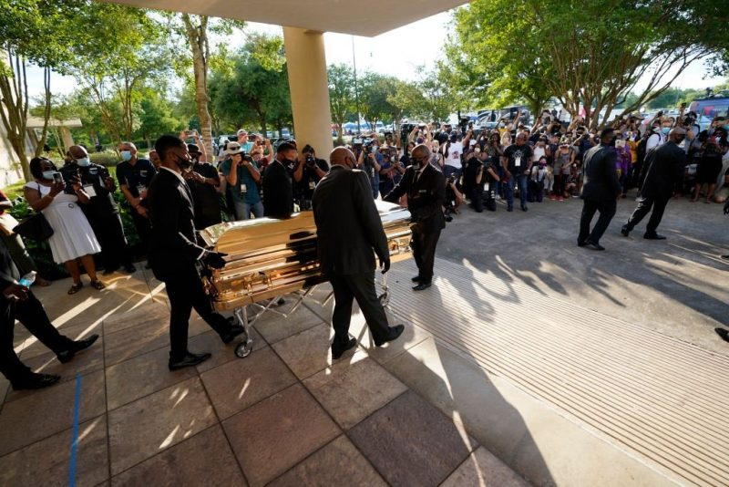 Thousands mourn George Floyd as accused officer appears in court