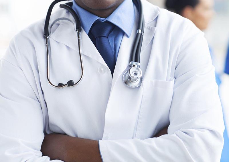 Zimbabwe seeks to slow exodus of doctors as economy collapses
