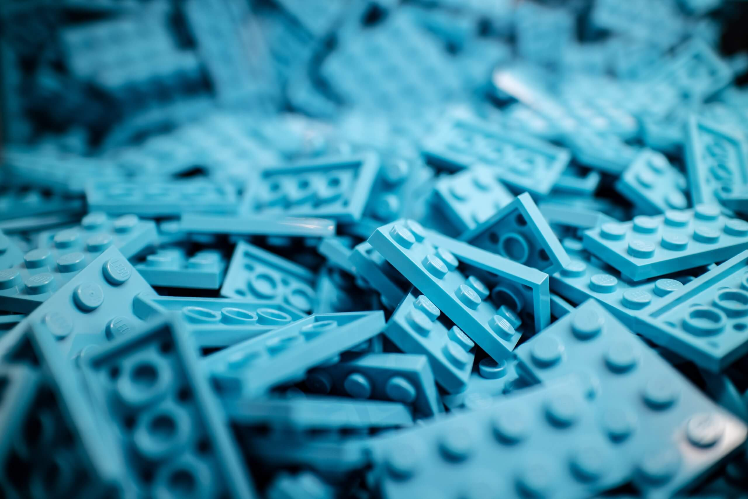 Blue lego brick in a pile