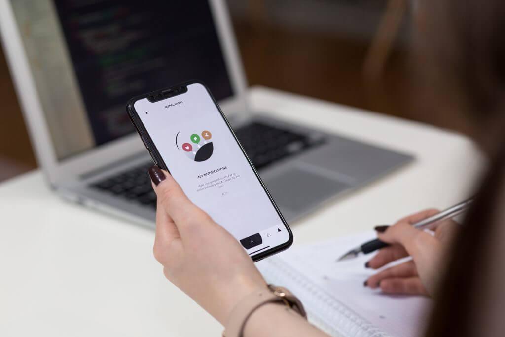 Responsive Website Design - Woman Holding Phone