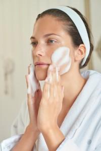 Cleansing - Brunette Model - Applying White Brightening Foaming Cleanser