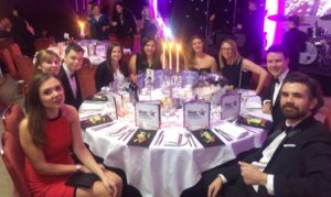 Ocastars sat around a candle lit table at the 2017 Engage Awards