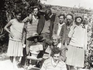 Bloomsbury Group posing by a garden wall