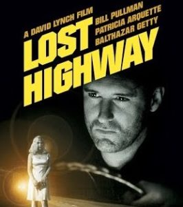Poster for Lost Highway featuring a man at a steering wheel with a full shot of a woman in the bottom right corner.