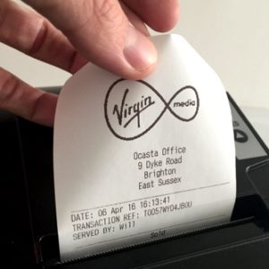 Virgin Media receipt being printed With the Ocasta Office address on it