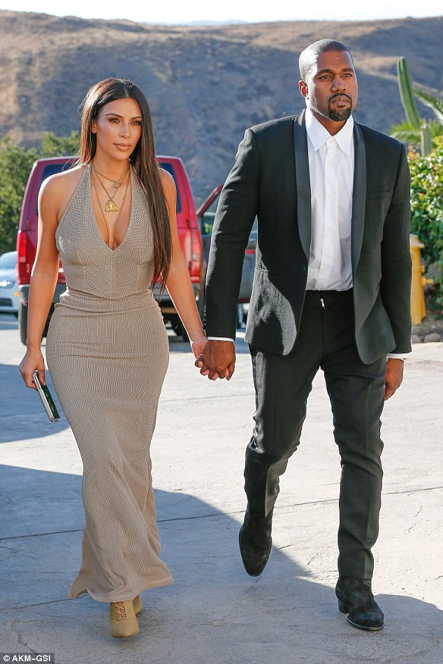 SPOTTED: Kanye West Suits Up In Saint Laurent