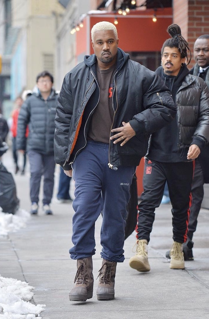 SPOTTED: Kanye West In Gosha Rubchinskiy Sweatpants, Raf Simons Jacket and Yeezy 950 Boots