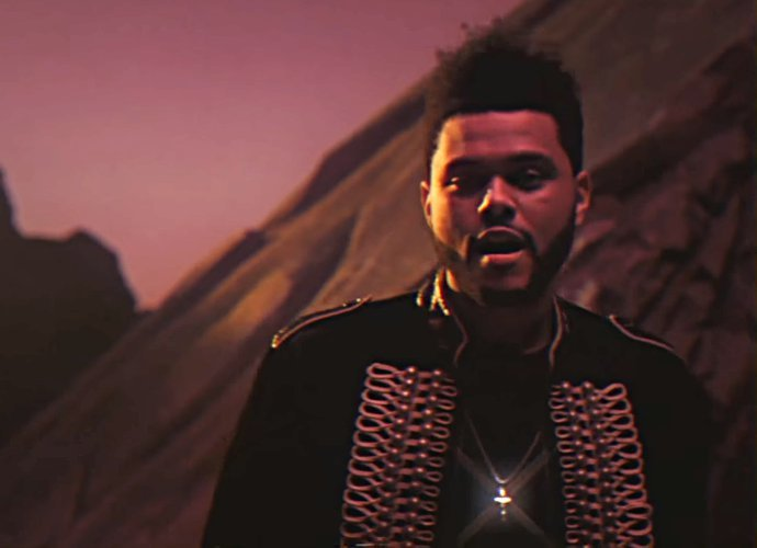 "SPOTTED: The Weeknd In ""I Feel It Coming"" Music Video In Saint Laurent Jacket"