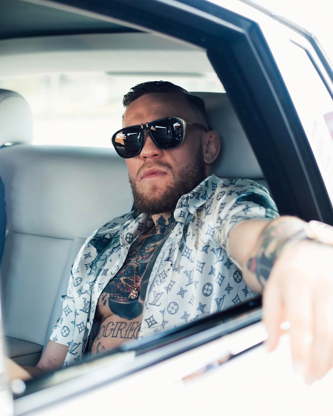 SPOTTED: Two Looks From Conor McGregor – Louis Vuitton Shirt And Saint Laurent Sneakers