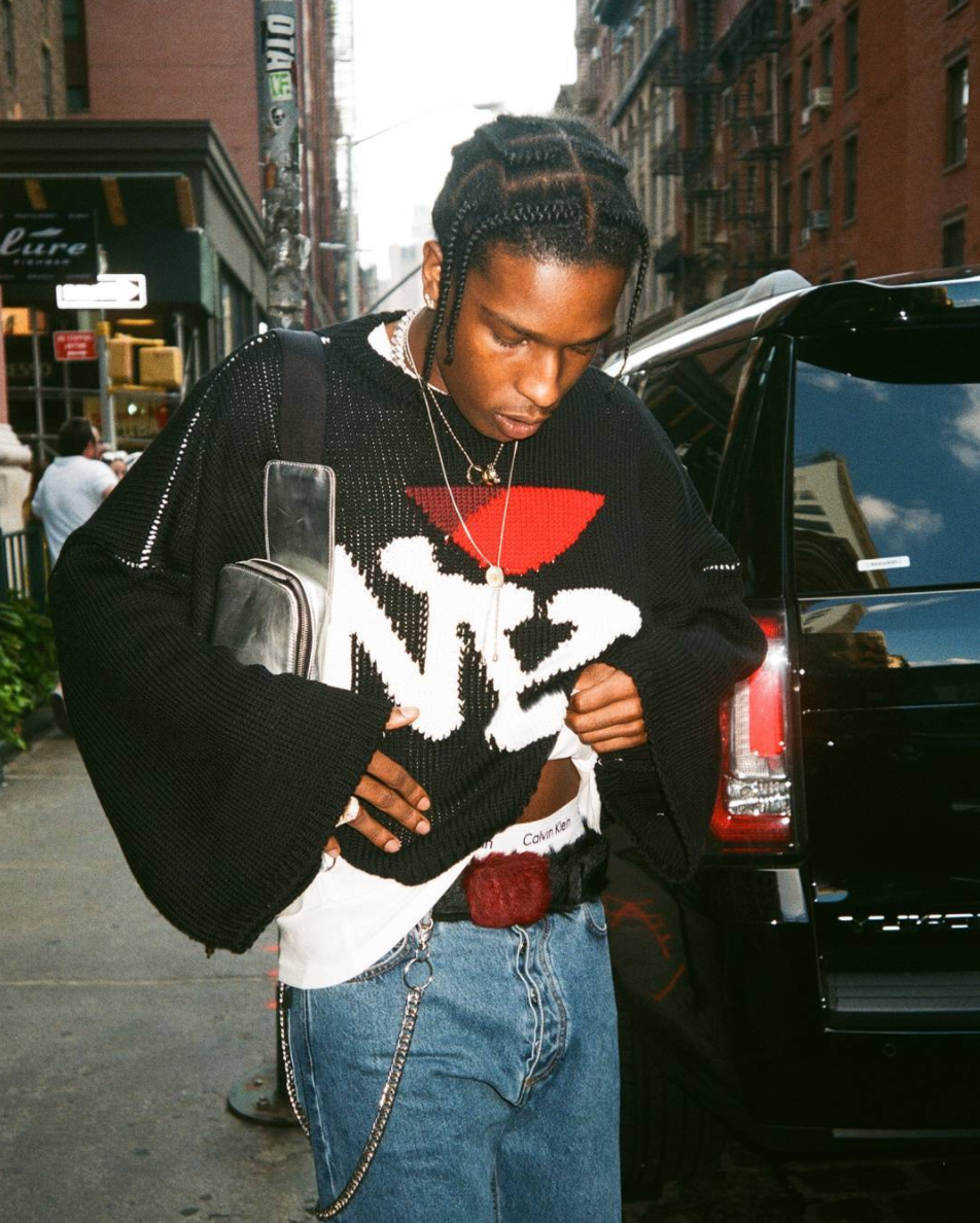 SPOTTED: A$AP Rocky In Raf Simons Sweater, Prada Belt, Calvin Klein Briefs And Vans Sneakers