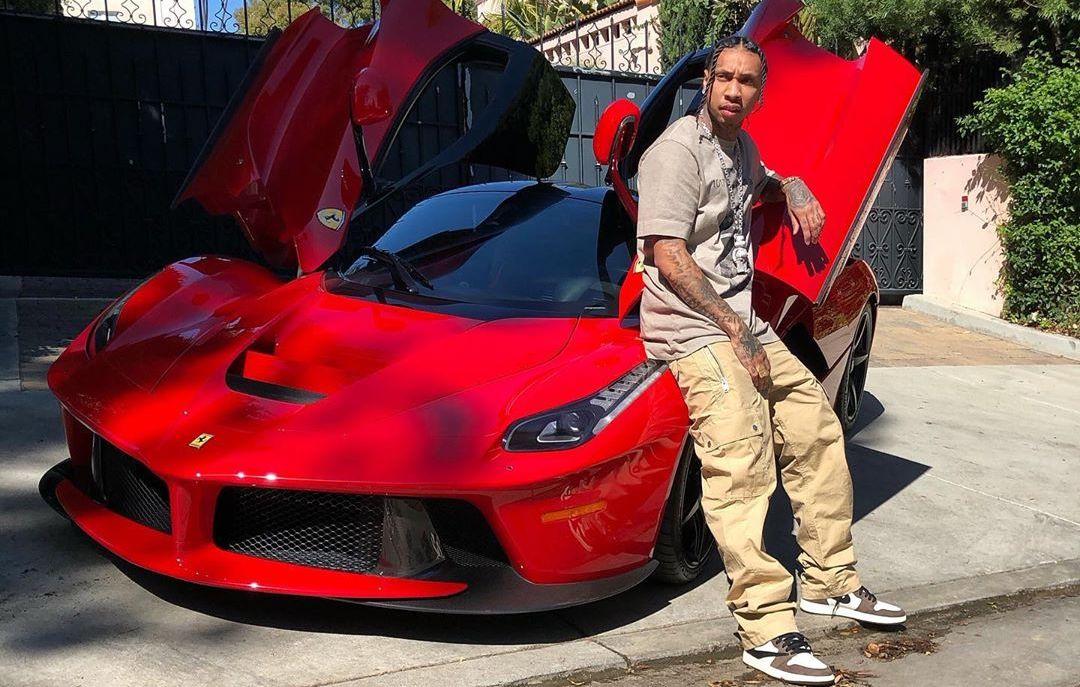 SPOTTED: Tyga Shows Off His Farrari in Travis Scott x Nike AJ1