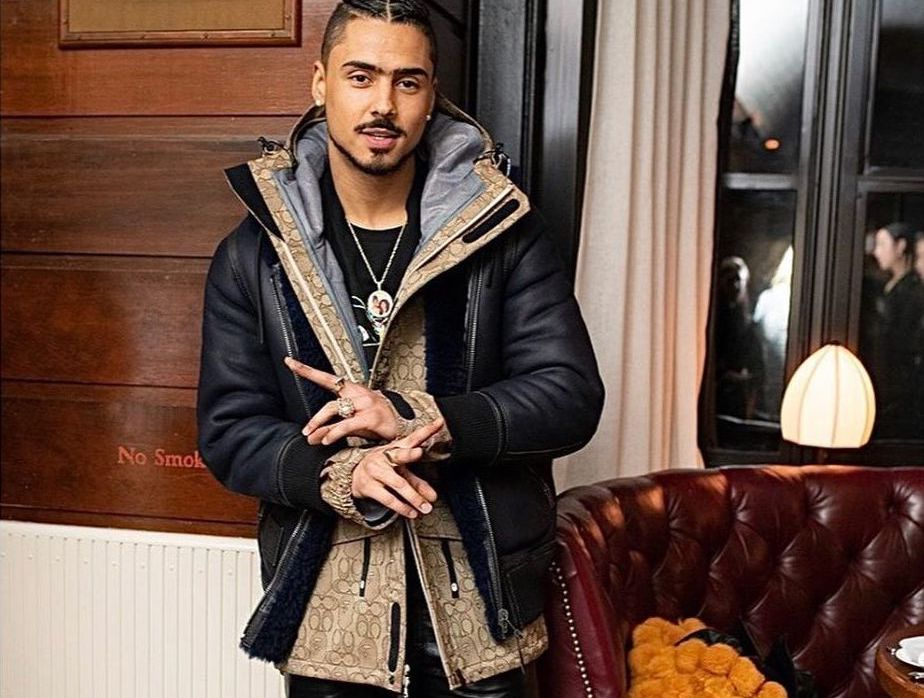 SPOTTED: Quincy attends NYFW Coach Dinner in Black Shearling Jacket