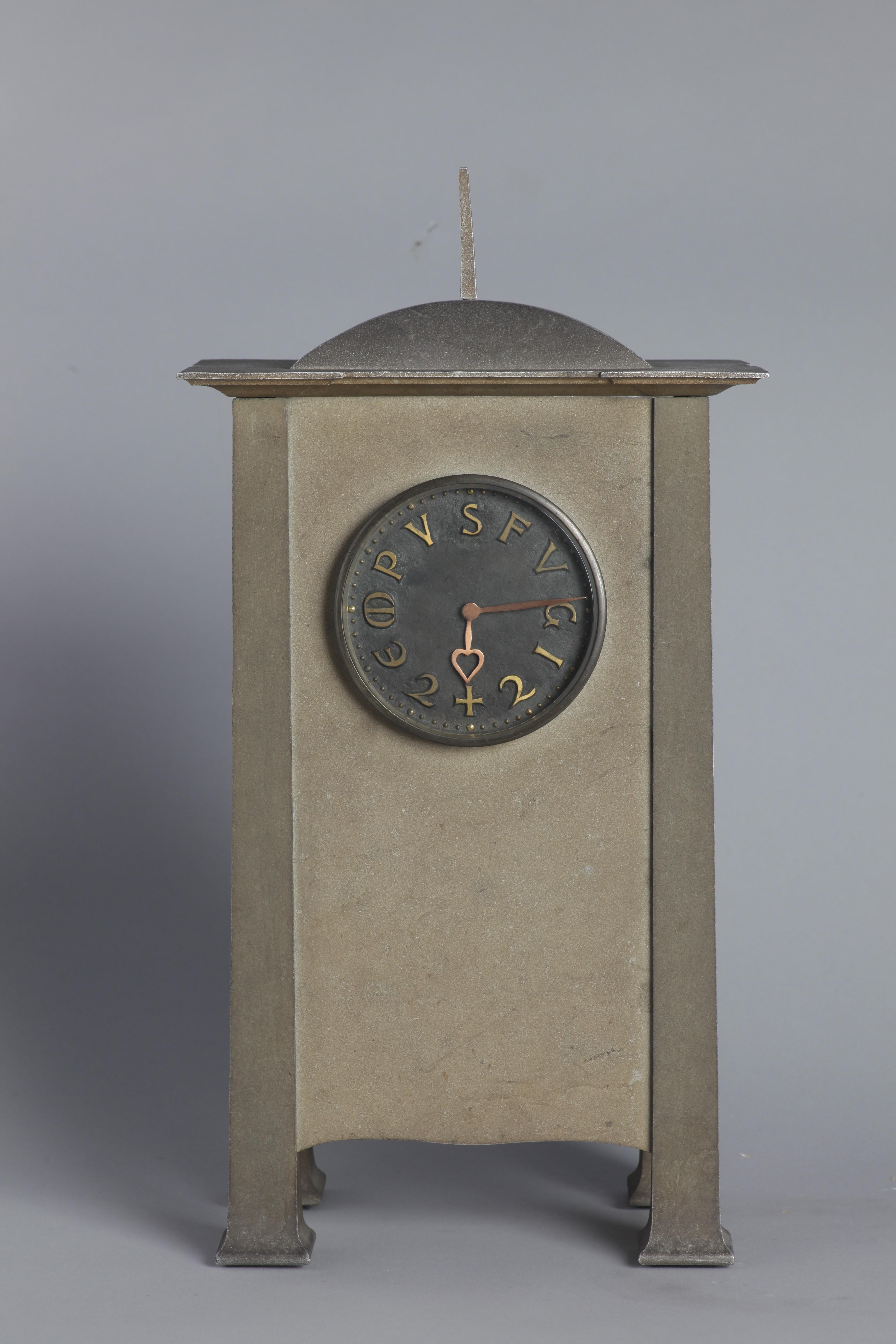 Voysey aluminium clock