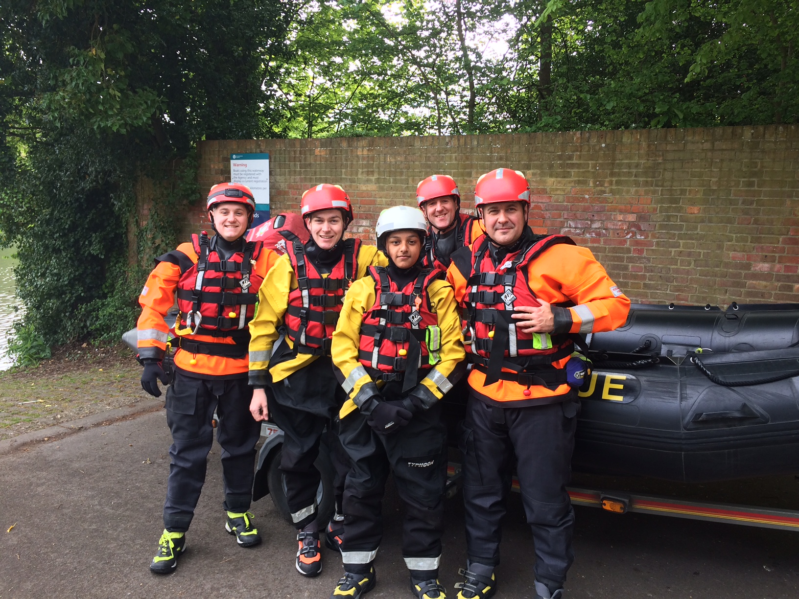 work experience group fully dressed in water kit