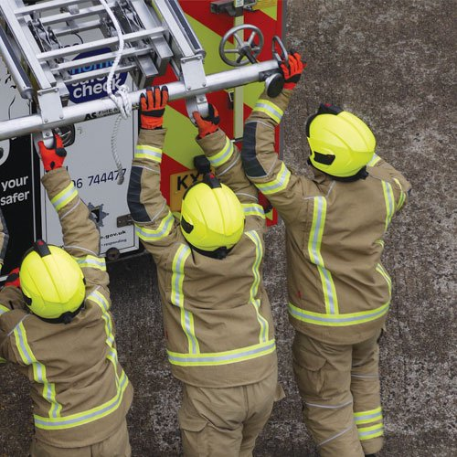 firefighters loading a ladder on a fire engine