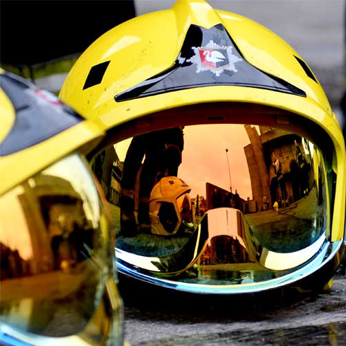 a photo of a fire fighter helmet on the ground