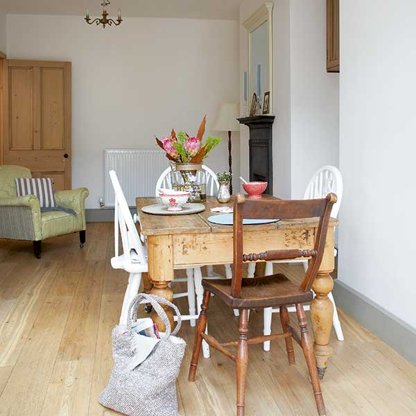 second handing dining table and chairs in a cottage kitchen diner